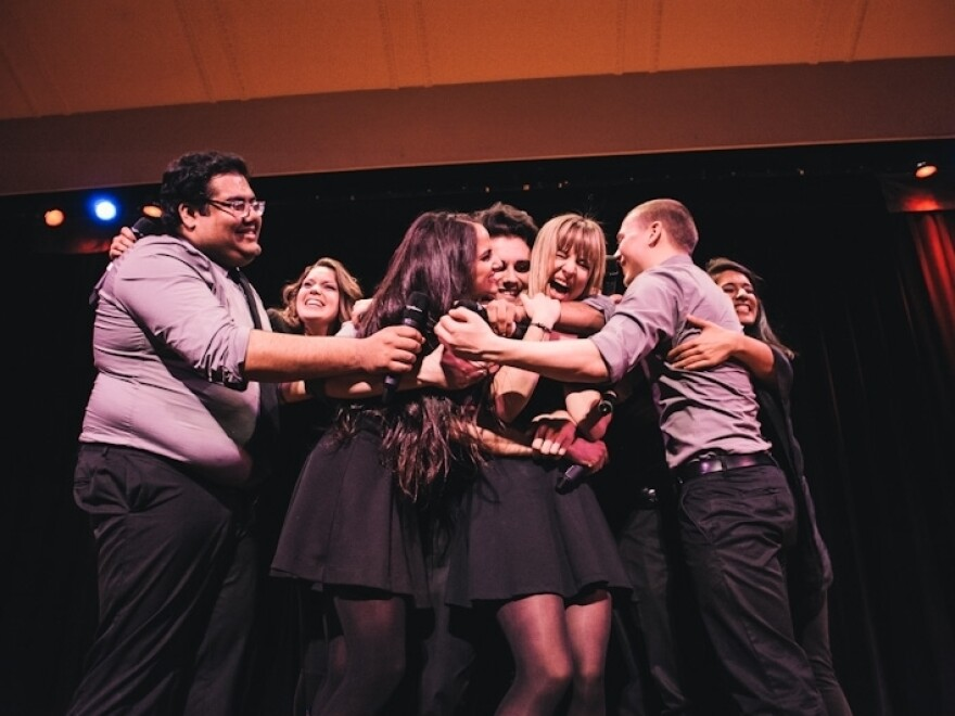 The Northeastern University Nor'easters celebrate after winning at the ICCA finals.