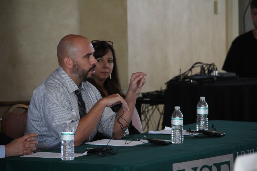 Panelists Daniel Martinez and Elizabeth Aranda answer questions about immigration policy.