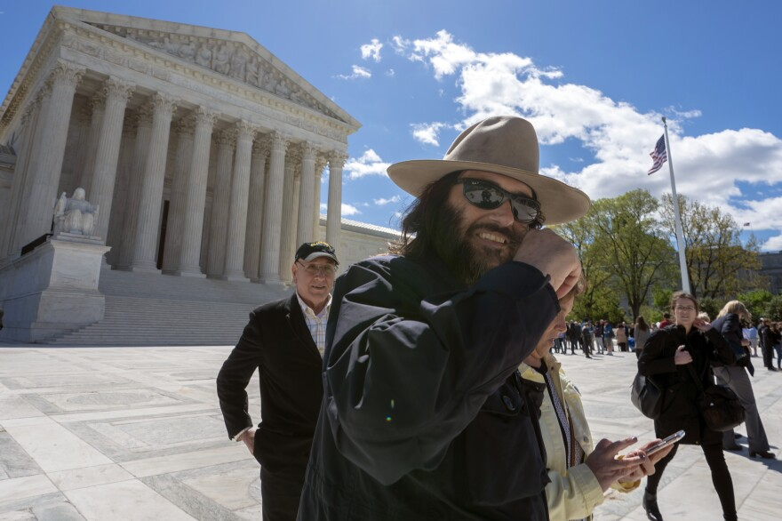 Los Angeles artist Erik Brunetti, the founder of the streetwear clothing company FUCT, leaves the Supreme Court after his trademark case was argued on April 15.