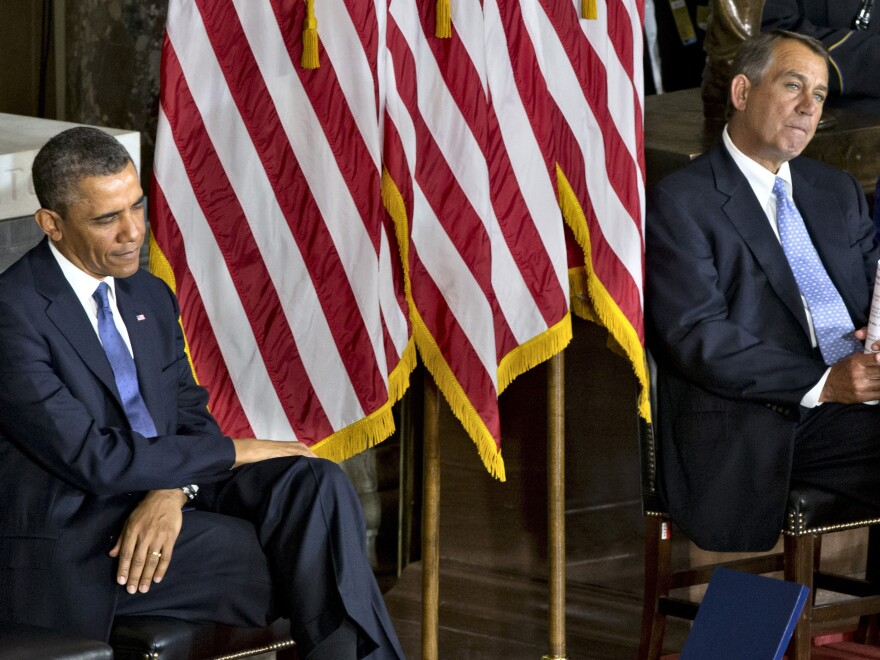 President Obama and House Speaker John Boehner sit together at a Capitol event in February dedicating a statue of civil rights icon Rosa Parks.