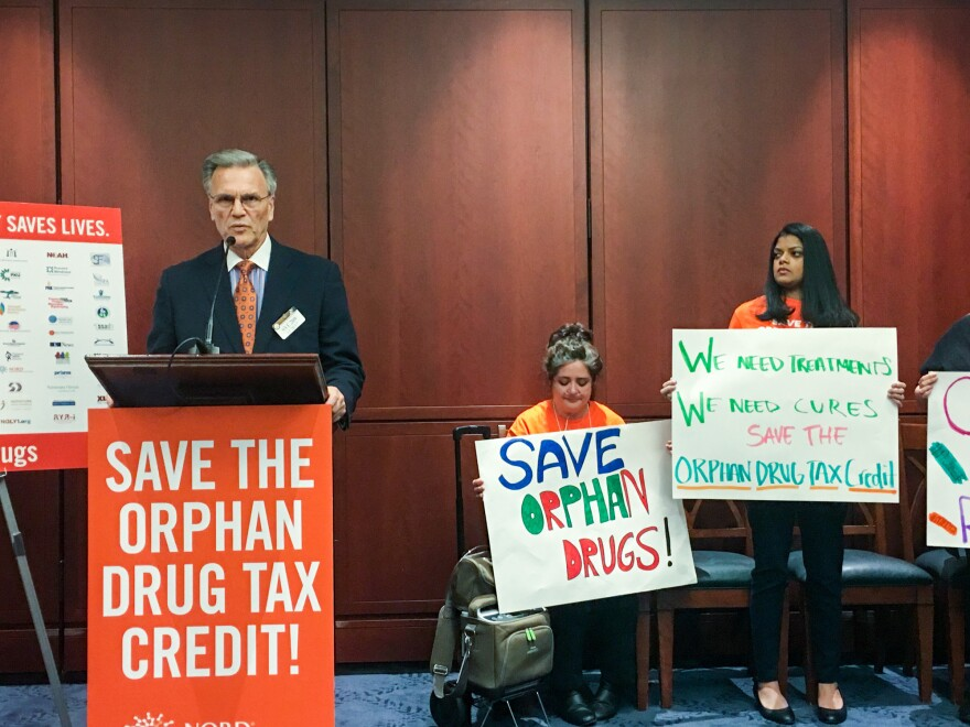 Peter Saltonstall, president of the National Organization of Rare Disorders, speaks at a rally Tuesday in support of tax credits for companies that develop drugs for rare diseases.