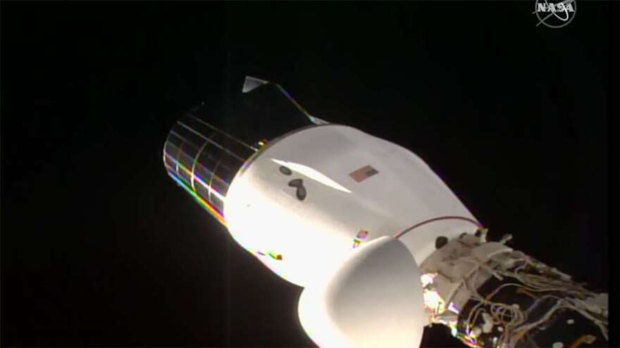 The SpaceX Cargo Dragon vehicle is pictured docked to the Harmony module's space-facing international docking adapter. Photo: NASA TV