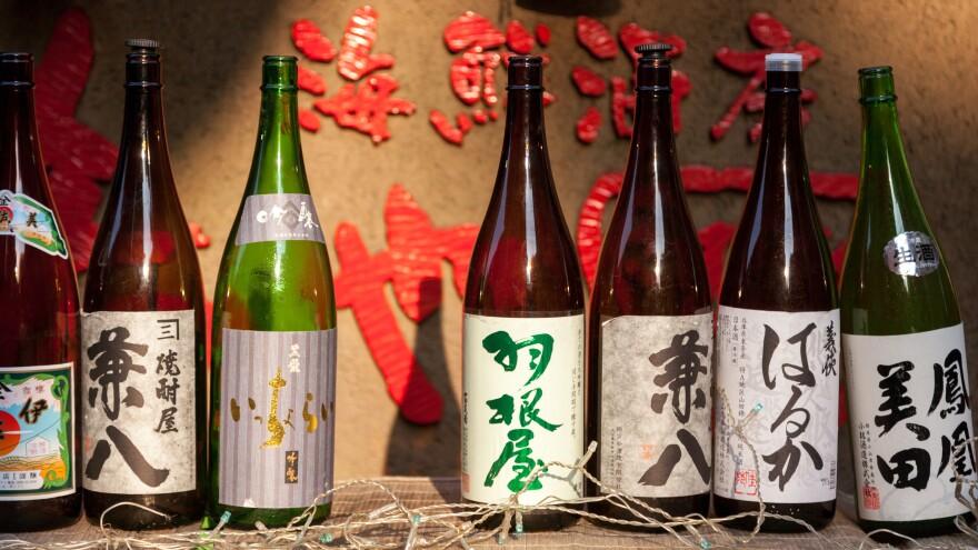 Empty sake bottles lined up outside a restaurant in the Daikanyama area of Tokyo.
