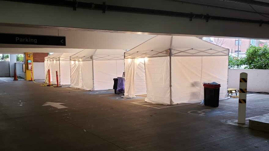These three tents in a parking garage at UW Medical Center Northwest make up a drive-through coronavirus testing clinic for symptomatic employees.