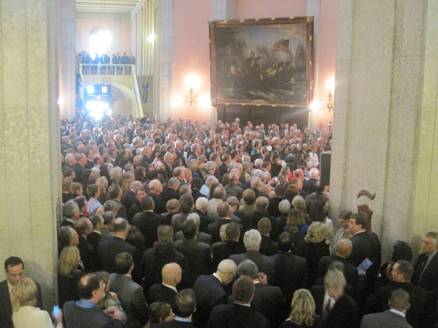 Hundreds of people packed Mike DeWine's first inauguration as Attorney General in the Statehouse Rotunda in January 2011.