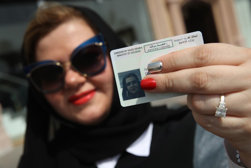 Nada Edlibi holds up her Saudi driver's license in Jeddah on Sunday, the first day that she is legally allowed to drive in Saudi Arabia.