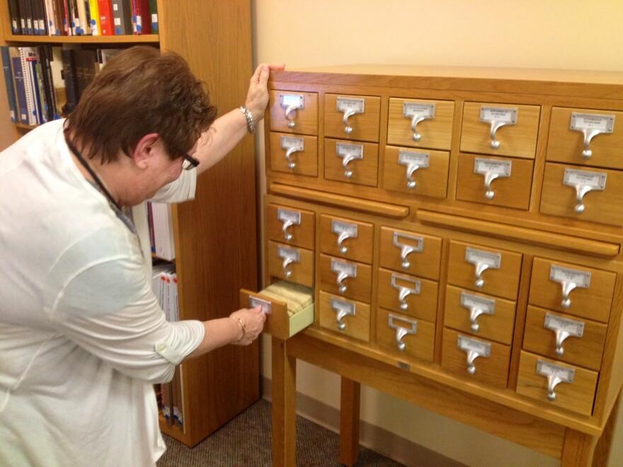 Nancy Horlacher looks through her files at the Dayton Metro Library.