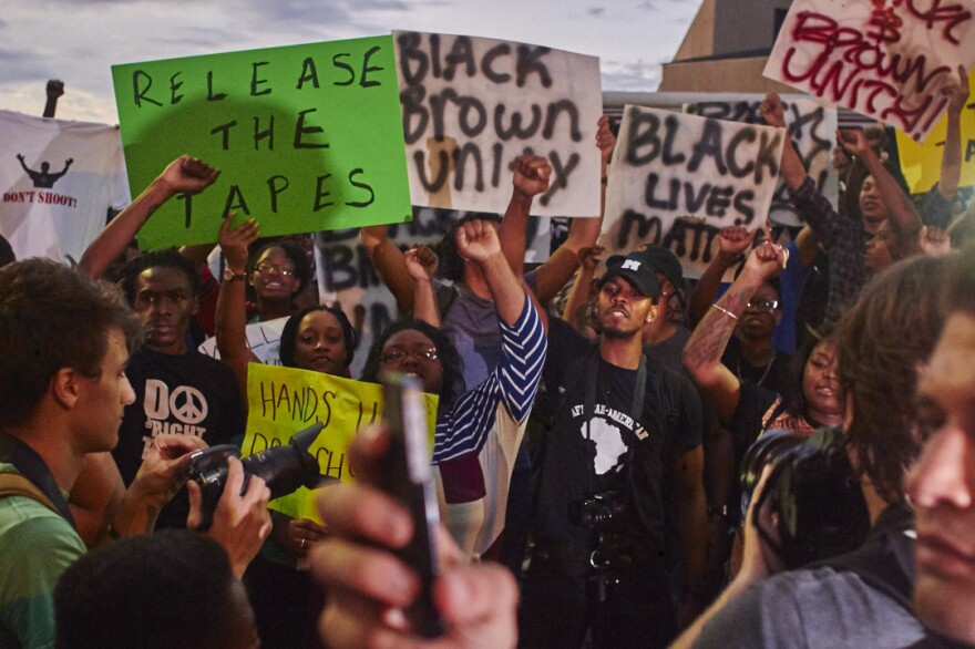 "Police and protesters give different accounts of what happened before Scott was killed. Police say he was brandishing a gun; protesters say he was unarmed. Demonstrators have called for video footage of the incident to be made public. ""Release the tapes,"" these protesters in Charlotte urged Wednesday."