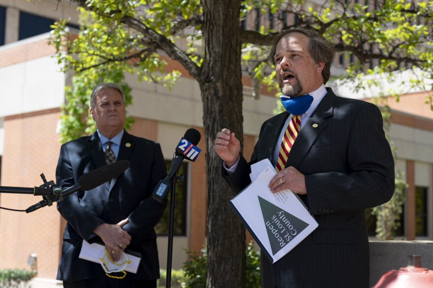St. Louis County Councilmen Mark Harder, right, and Tim Fitch, left, speak to reporters on April 30, 2020, about their plan to reopen businesses.