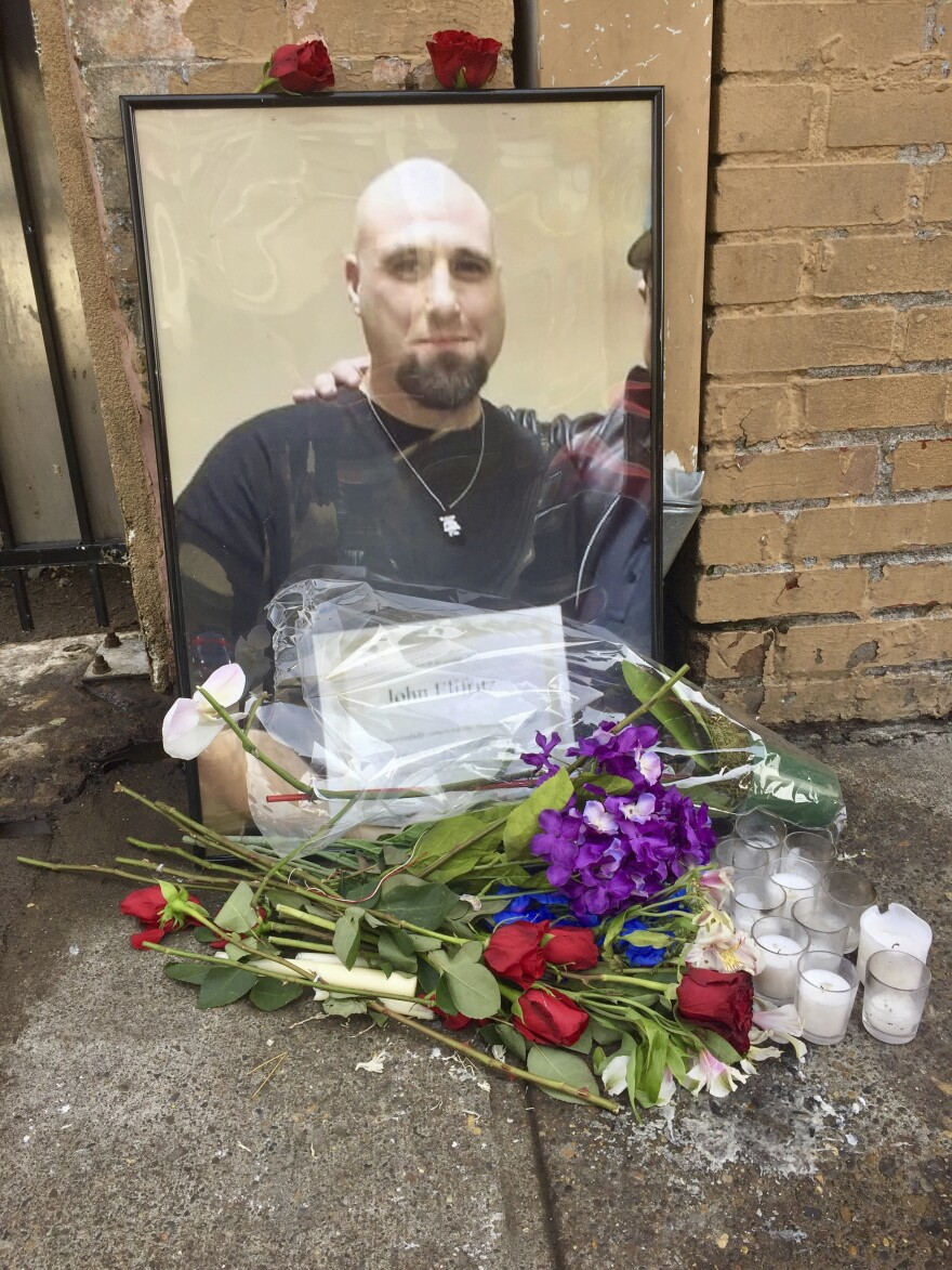 A memorial for John Elifritz, a carjacking suspect who was shot and killed by police, stands on a sidewalk in front of a Portland, Ore., homeless shelter on Monday. Groups and family members are raising questions about whether officers resorted to deadly force too quickly.