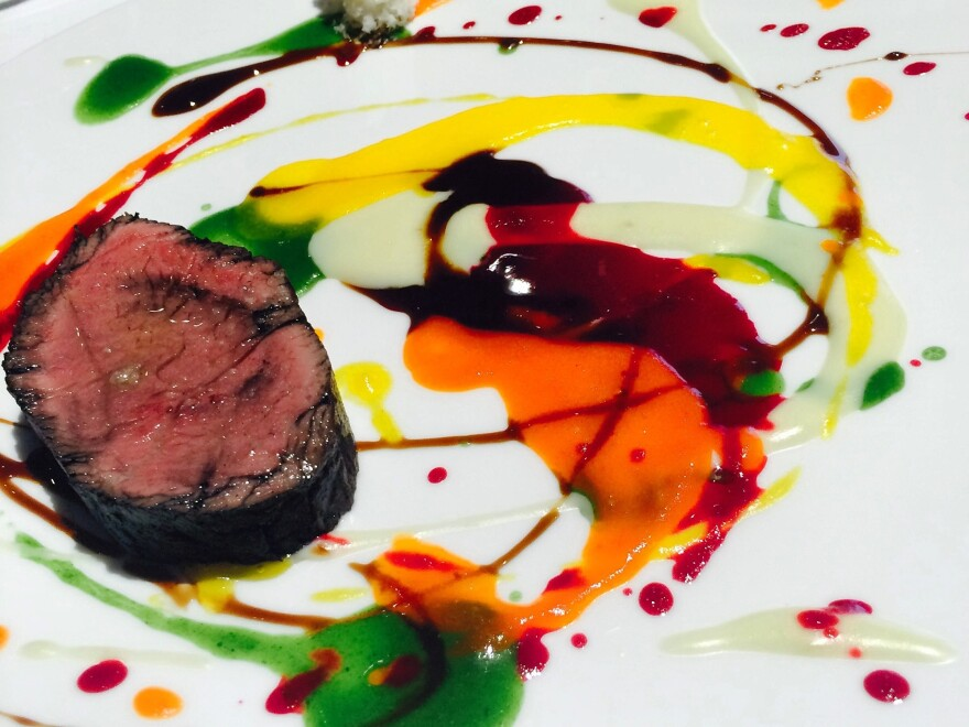 An artfully plated dish with tricolor sauces is served at Osteria Francescana, Chef Massimo Bottura's three-Michelin-star restaurant in Modena, Italy, which topped last year's list of the World's 50 Best Restaurants.