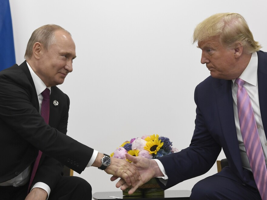 President Trump shakes hands with Russian President Vladimir Putin during a bilateral meeting on the sidelines of the G-20 summit in Osaka, Japan, on Friday.