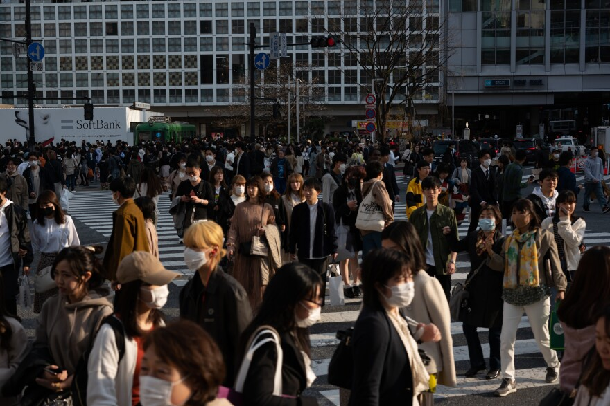 Crowds of people walk through Shibuya Crossing in Tokyo on Sunday, one of the busiest intersections in the world.
