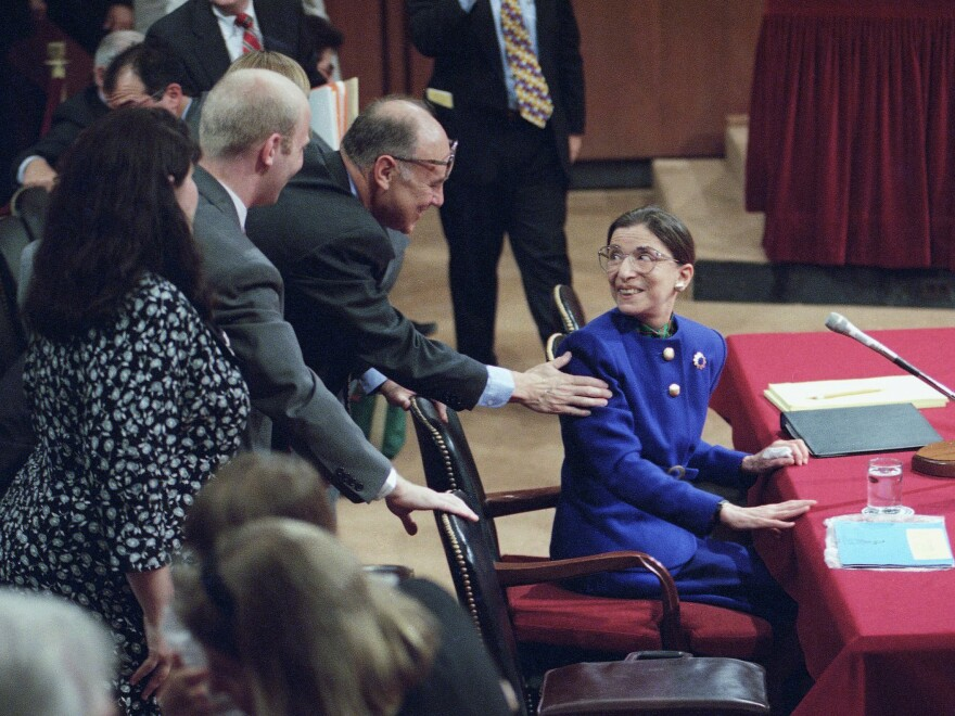 Then-Supreme Court nominee Ruth Bader Ginsburg greets her husband, Martin, during her confirmation hearing in 1993. She didn't hesitate to answer questions about <em>Roe v. Wade</em> and other topics<em> </em>she considered settled law.