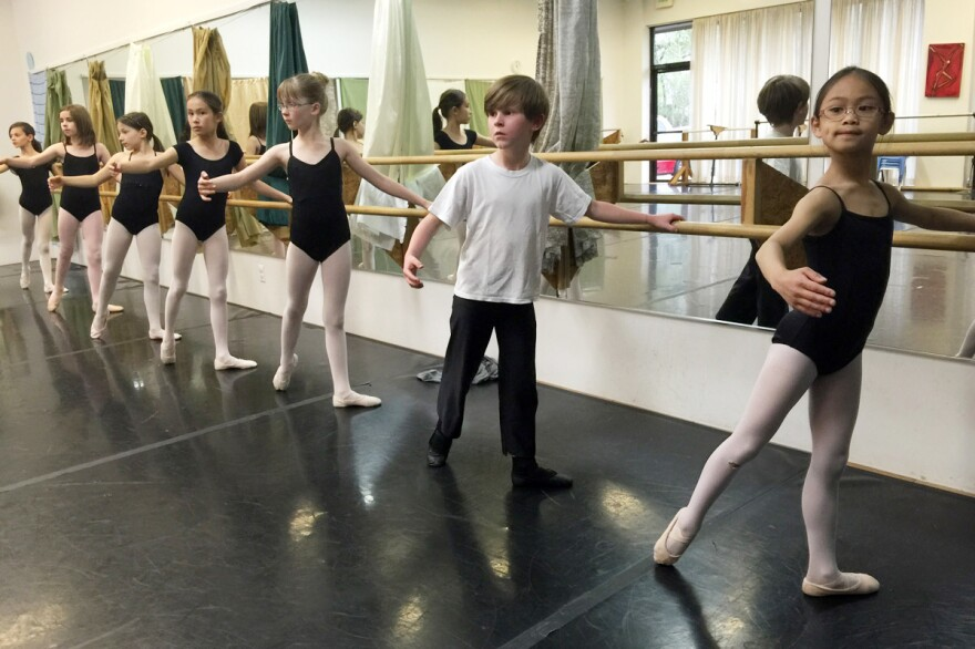 Finn Miller Vaughan, 8, practices at the barre at Canyon Concert Ballet in Fort Collins. He is the only boy in his ballet class.