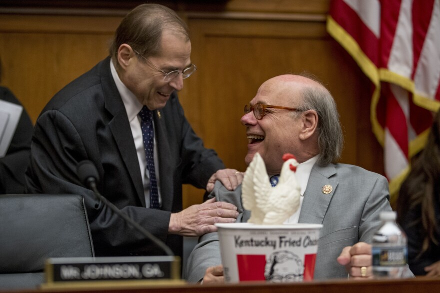 Judiciary Committee Chairman Jerrold Nadler, D-N.Y., left, laughs with Rep. Steve Cohen, D-Tenn., after Cohen arrived with a bucked of fried chicken and a prop chicken to sit in the place of an absent Attorney General William Barr.
