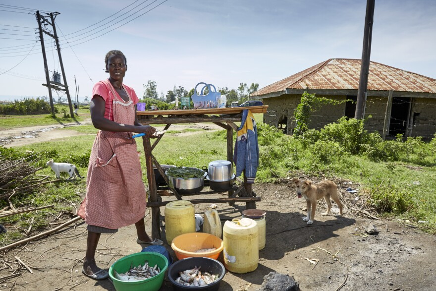 """Naomy Akoth, a widowed mother of eight, got her own boat through the No Sex For Fish project, but after a couple of years it was grounded. """"My heart was broken, and I felt low,"""" says Naomy, who now buys fish that she fries and sells at the market."""