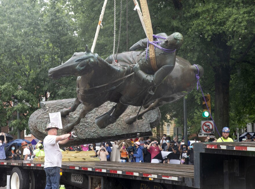 A Stonewall Jackson statue is loaded on a truck after being removed from Monument Avenue in Richmond, Va., on Wednesday.