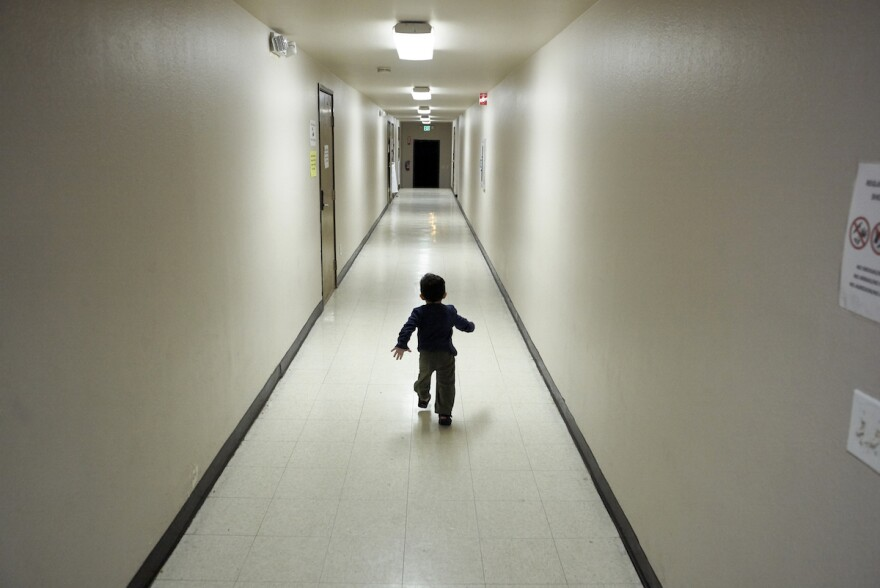 An asylum-seeking boy from Central America runs down a hallway of a shelter in San Diego after arriving from an immigration detention center on Dec. 11, 2018. Experts say when parents are detained or deported, the children's trauma can last a long time.