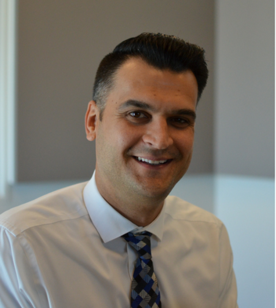 Nedim Ramic, a Bosnian refugee and attorney in south St. Louis, came to the United States in 1999.
