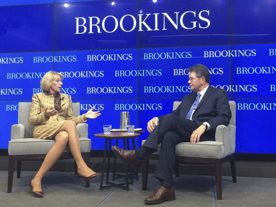 """Education Secretary Betsy DeVos talks with Grover """"Russ"""" Whitehurst, senior fellow in the Center on Children and Families in the Economic Studies program at the Brookings Institution on Wednesday in Washington."""