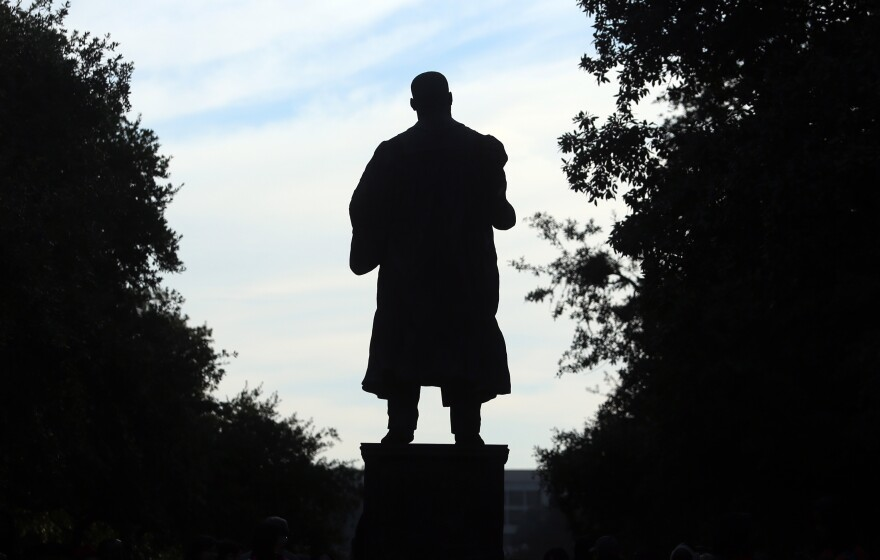 The shadow of a Martin Luther King Jr. statue posted on the University of Texas campus.