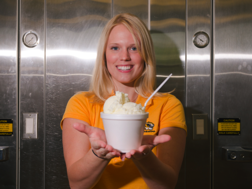 """Former University of Missouri graduate student Elizabeth Fenner poses with her """"flavor release""""€ ice cream that shifts from vanilla to cherry flavor in the mouth."""