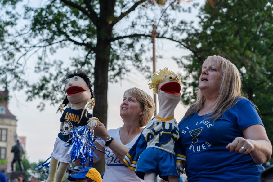 Joanne Reeds (right) and Victoria Sullivan dance at the Game 6 watch party with Blues puppets they made more than three decades ago. Reeds, of Ontario, Canada, made the puppet 37 years ago for her brother Mark Reeds, who played for the Blues. 6/9/2019