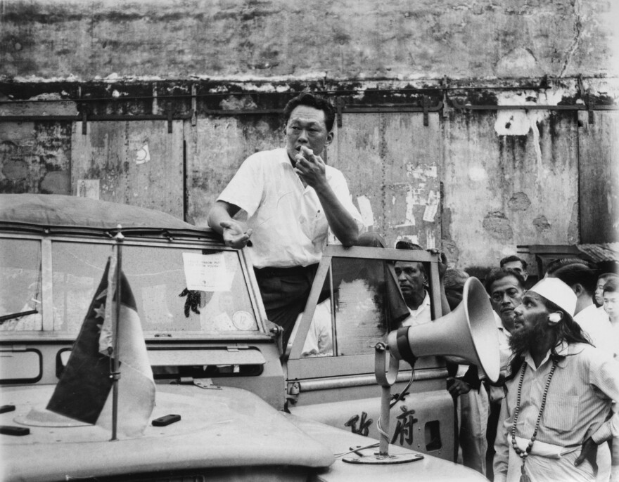 Singapore Prime Minister Lee Kuan Yew addresses a crowd in a slum area on July 29, 1964. Lee, popular with the masses, asked for a halt in the racial strife that struck the island city.