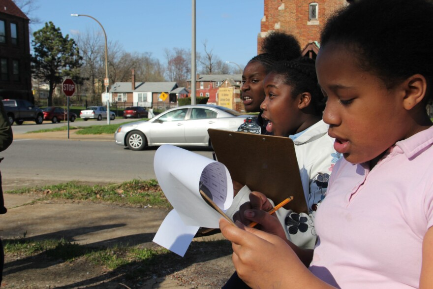 The girls who attend after-school programs run by the Throwing and Growing Foundation make notes on the gardening potential of vacant lots around the closed St. Matthews Lutheran School.