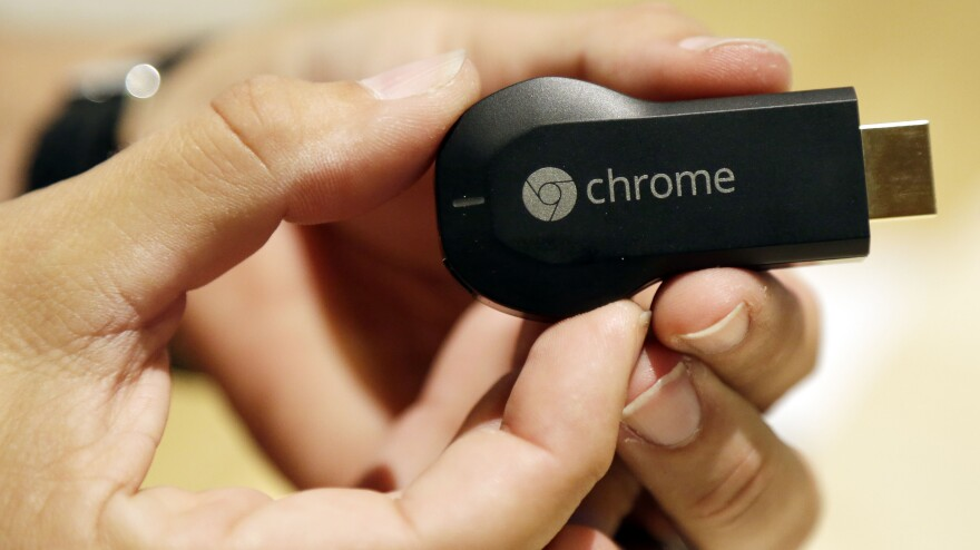 The new Google Chromecast device is shown on July 24, 2013, in San Francisco.