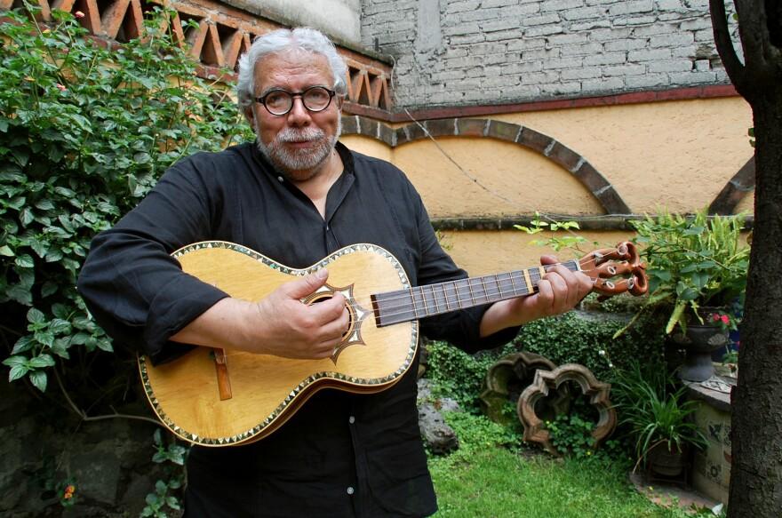 Guillermo Contreras strums the five-string <em>guitarra de golpe</em>.