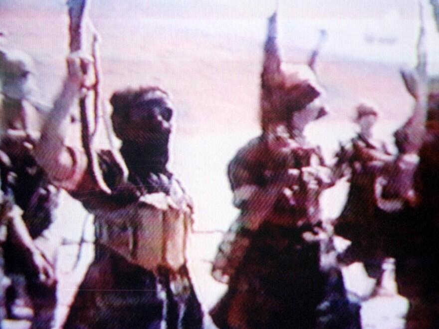June 2001: al-Qaida members training in Afghanistan (frame grab from an al-Qaida video).
