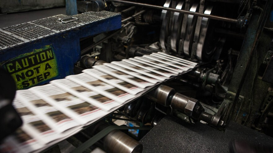 Copies of <em>The Orange County Register</em> slide through the presses. <em>The</em> <em>Register</em> is the country's 20th most-read daily, with a circulation of about 285,000.