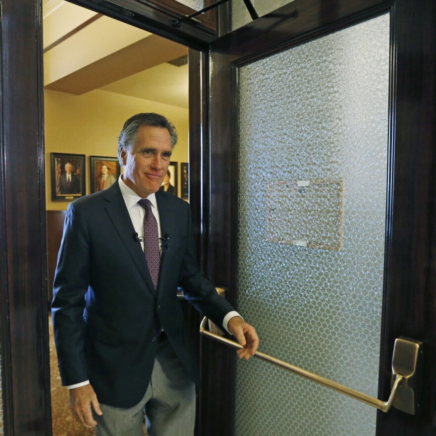 Mitt Romney leaves the state elections office after declaring his candidacy for the U.S. Senate last month at the Utah State Capitol in Salt Lake City.