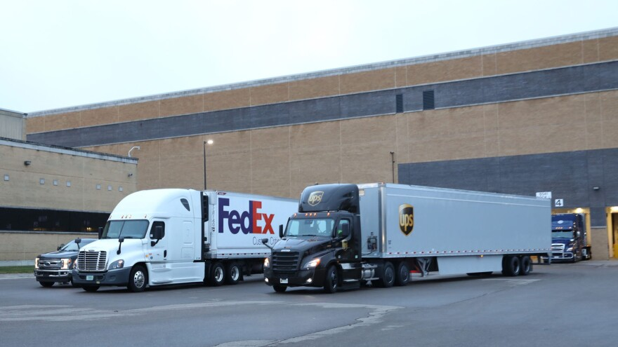 pfizer trucks delivering vaccine from michigan plant 121420.jpg