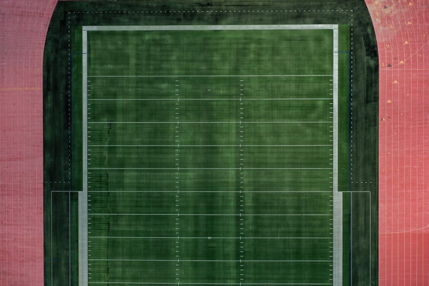 An aerial view of an empty football field at Towson University in Towson, Md. Many colleges rely on summer camps for additional revenue during the summer.