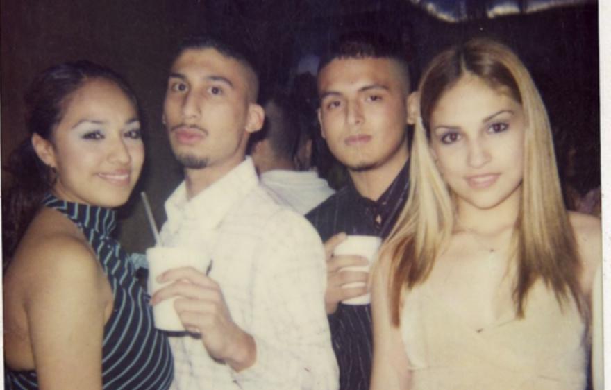 Bart Reta and Gabriel Cardona, Zeta hit men, pose with two young women at a party.