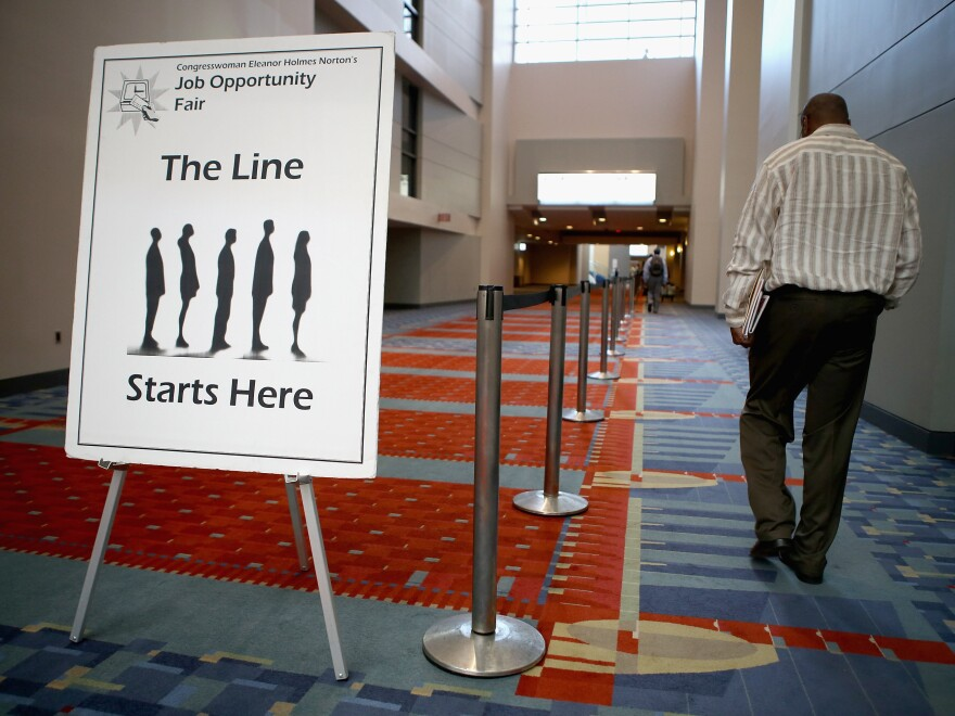 """A job fair was held at the The Walter E. Washington Convention Center in Washington, D.C., last month. The U.S. unemployment rate declined in August in part because the number of """"discouraged workers"""" climbed."""