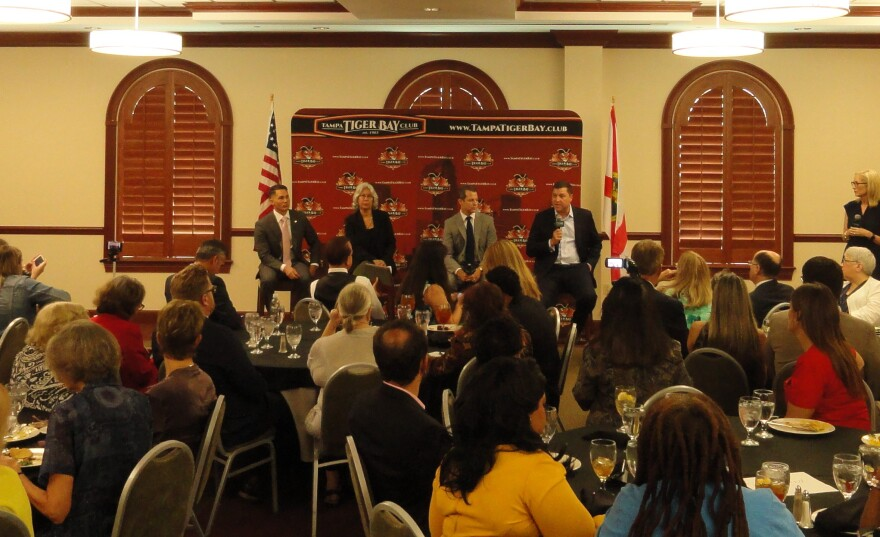 Four panelists speak to members and visitors at Tampa Tiger Bay Club.