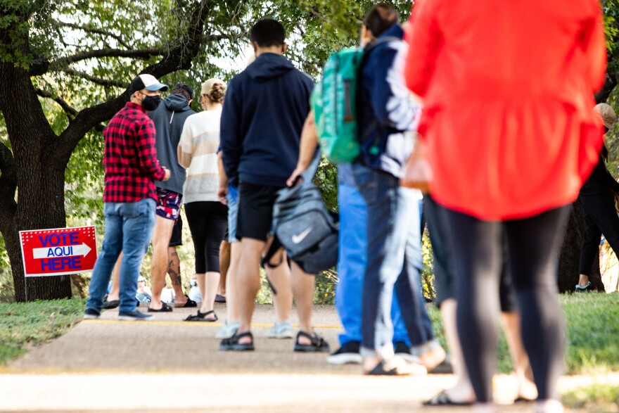 People line up to vote at the South Austin Recreation Center on the first day of early voting in Texas.