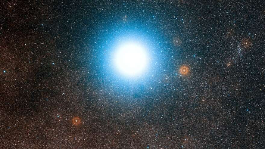 An image from the European Southern Observatory shows the sky around the bright star Alpha Centauri — which appears so large because of the telescope optics and photographic emulsion — taken from photos in the Digitized Sky Survey 2. Alpha Centauri is the closest star system to Earth's solar system.<strong></strong>