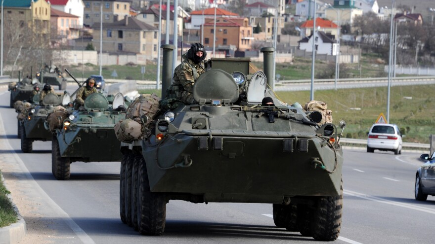 Russian armored vehicles drive on a road in Crimea on March 17. Members of the Good Judgment Project are asked about the likelihood of world events such as Russia's recent annexation of Crimea.