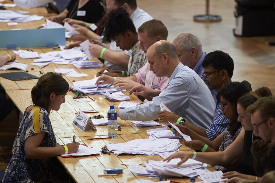 Vote-counting staff sort ballots at The Royal Horticultural Halls in central London on Thursday. The referendum was held on paper ballots, counted by hand.