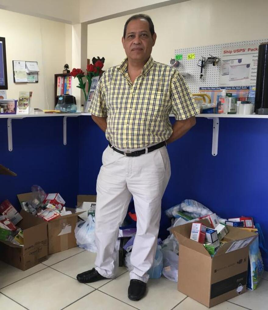 Norman Fitoria, standing among donated medical supplies on Monday, June 4