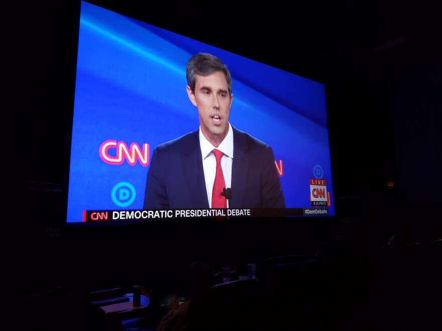 Former Congressman Beto O'Rourke on the screen at Alamo Drafthouse, where Texas Democrats held a watch party for the presidential primary debates.