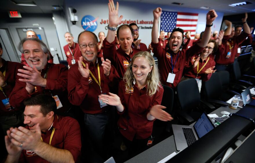 NASA engineers on the flight team celebrate the InSight spacecraft's successful landing on Mars at the NASA Jet Propulsion Laboratory in Pasadena, Calif., on Monday.