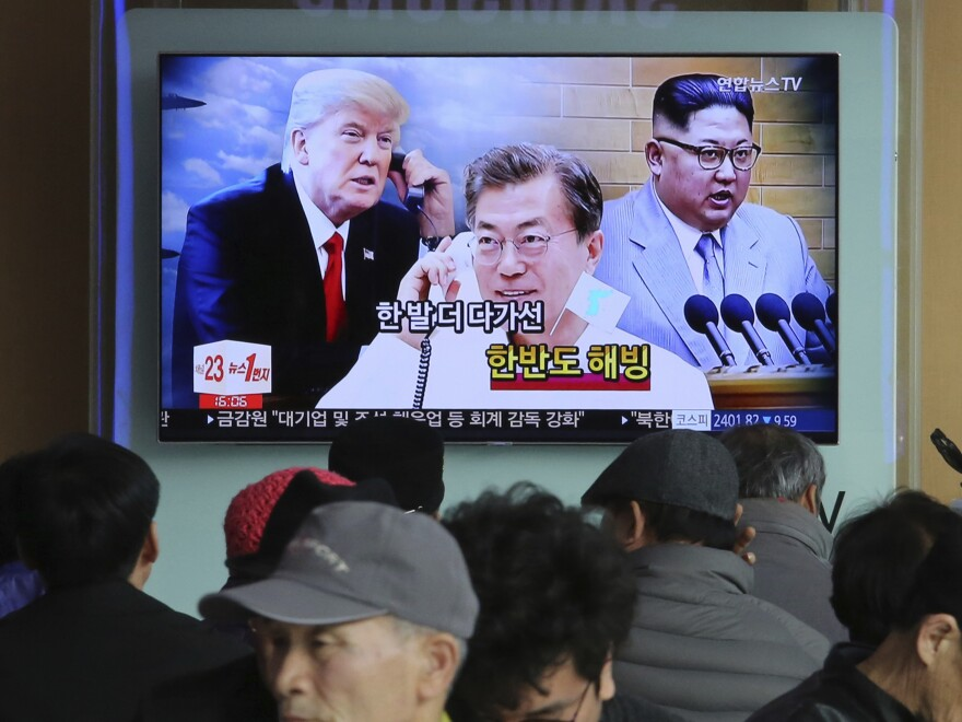People watch a TV screen showing images of North Korean leader Kim Jong Un, right, South Korean President Moon Jae-in, center, and  President Trump at the Seoul Railway Station in Seoul, South Korea, last month.