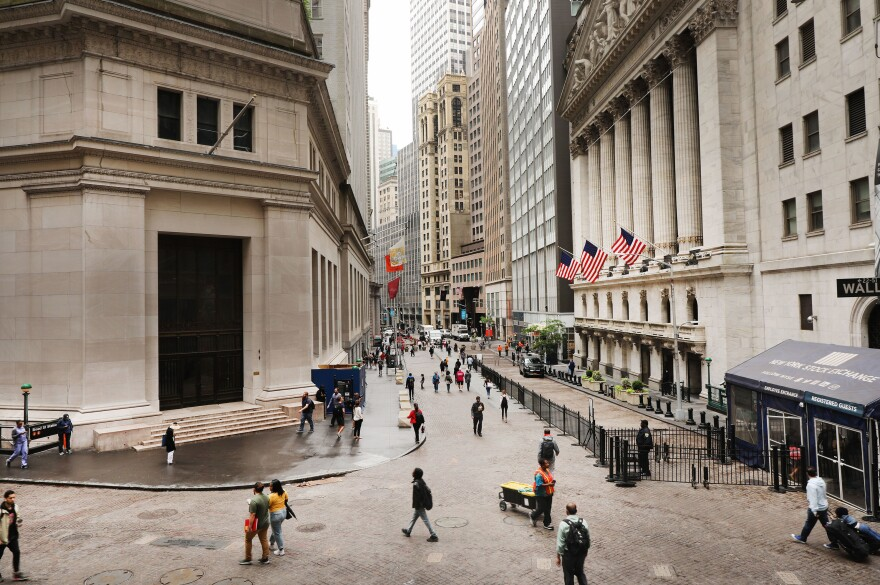 Investors are spending billions of dollars to align their portfolios with their personal values. But there's little agreement on what exactly qualifies — or disqualifies — an investment option from being marketed as sustainable. Above, pedestrians walk past the New York Stock Exchange on June 10.