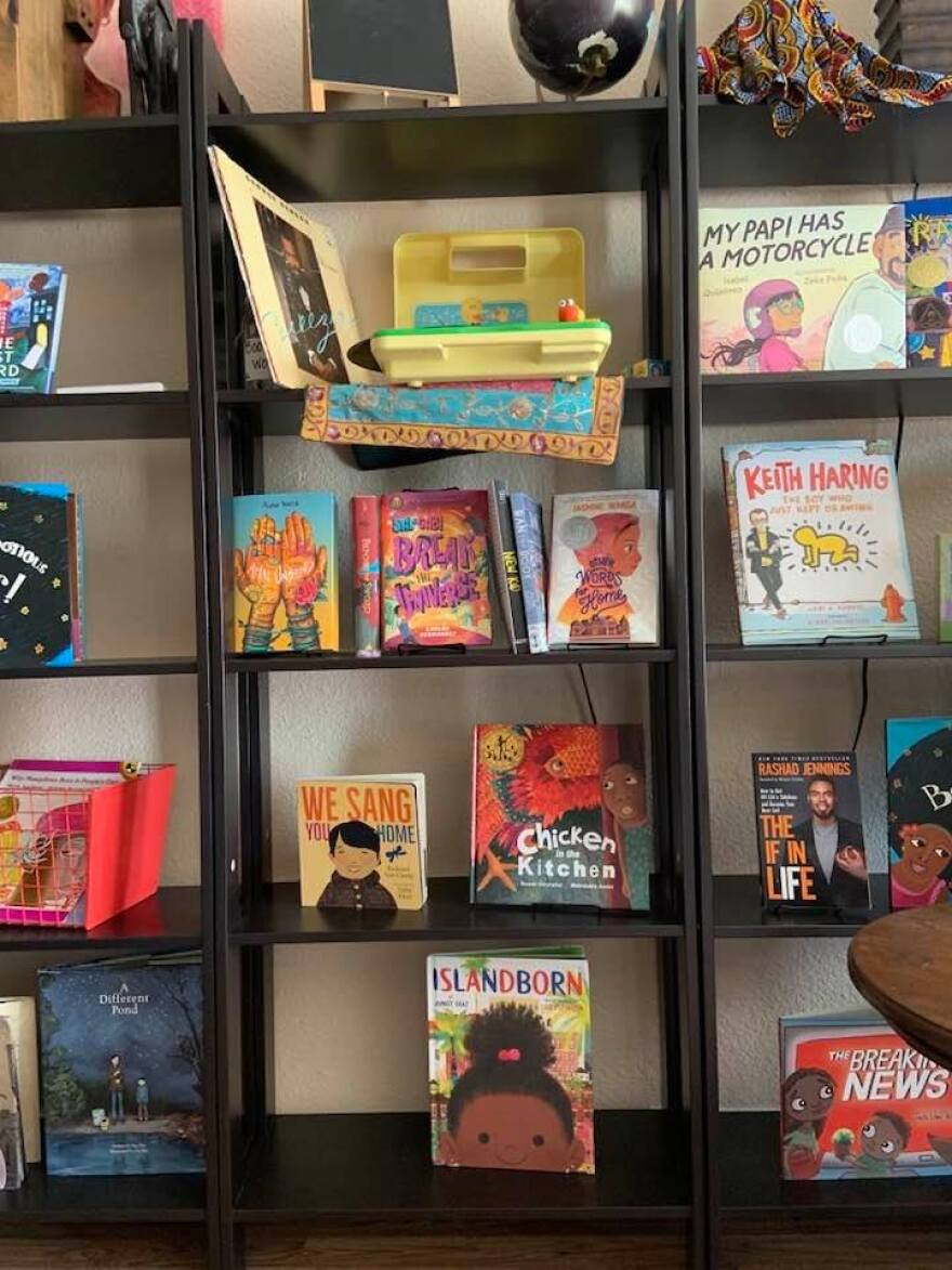 A bookshelf with children's books about people of color, multiculturalism and diversity